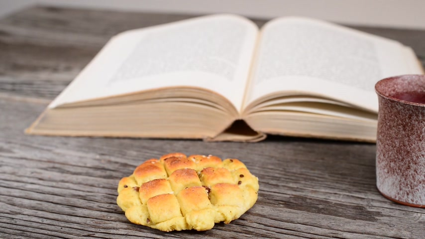 communion : bible with chalice and bread, panning,sliding
