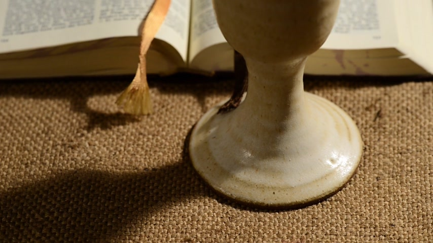 communion : bible with chalice, panning,sliding, tilt