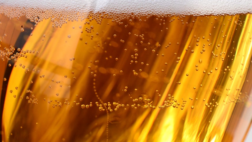 beer tap : bubbles in the beer glass, locked down Stock Footage