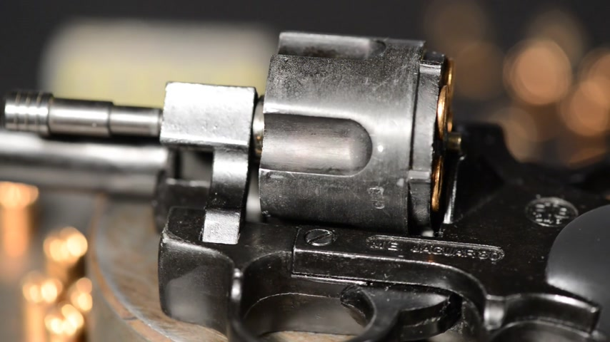 firearms : detail of revolver with cartridges,panning,rotation