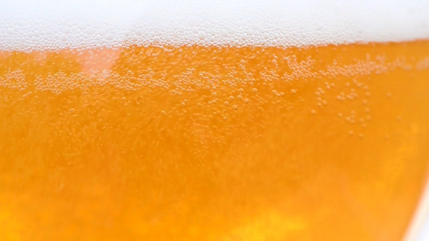 beer tap : detail of beer glass,rising bubbles Stock Footage