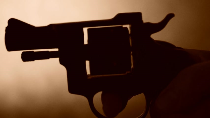disarming : silhouette of a mans hand with a handgun,real time