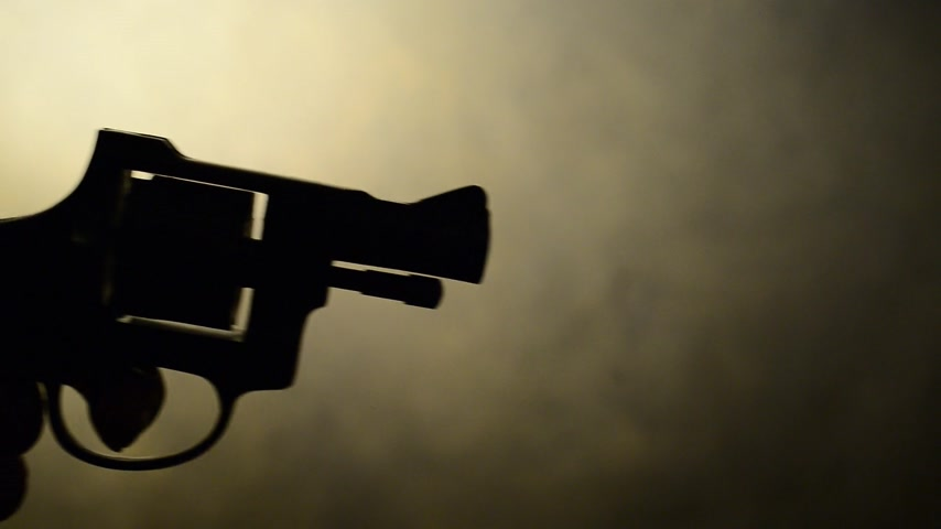 disarming : silhouette of handgun,motion effect,