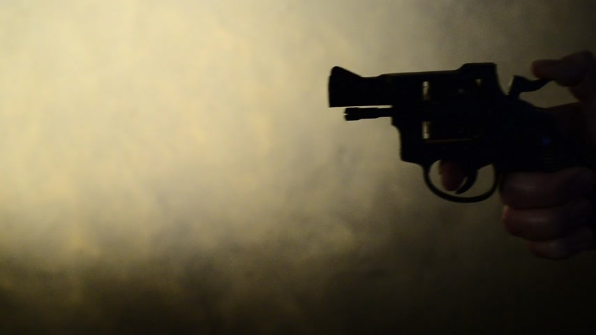 eim : silhouette of a mans hand with a handgun,real time