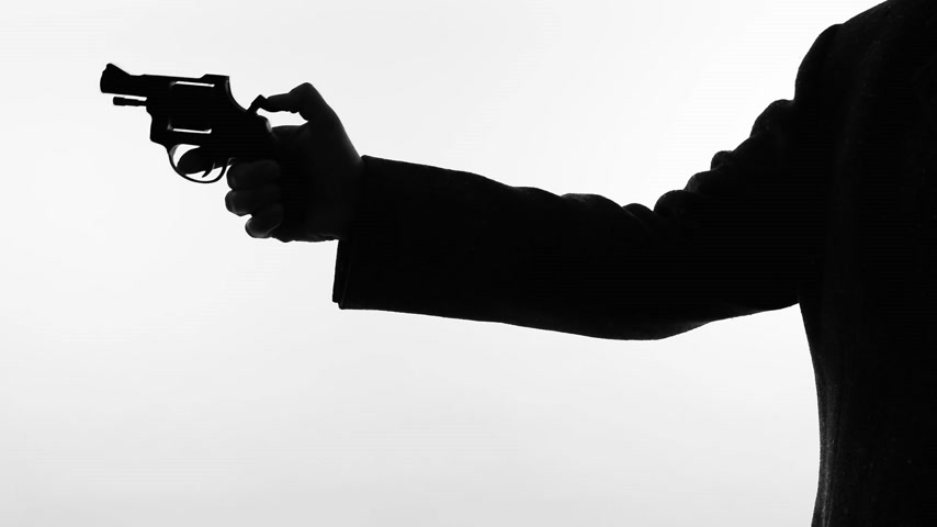 disarming : man shooting a handgun,real time,isolated,studio lighting