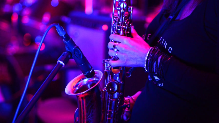 saxofone : detail of saxophonist player at the rock concert, no sound, real time, zoom in