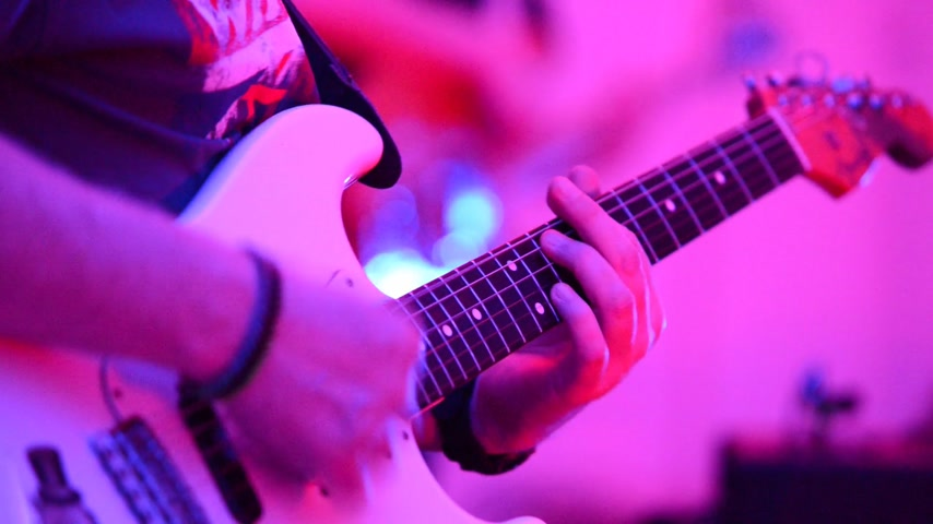 gitáros : detail of guitarist player at the rock concert, no sound, real time