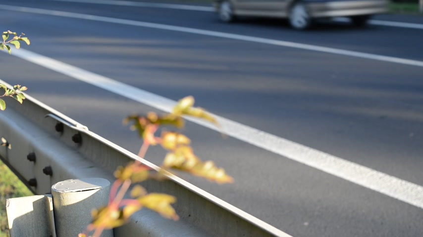 ограждение : detail of crash barrier with speeding cars, real time, with sound