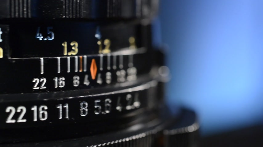 into focus : Lens turns and comes into focus in real time without sound, no camera movement