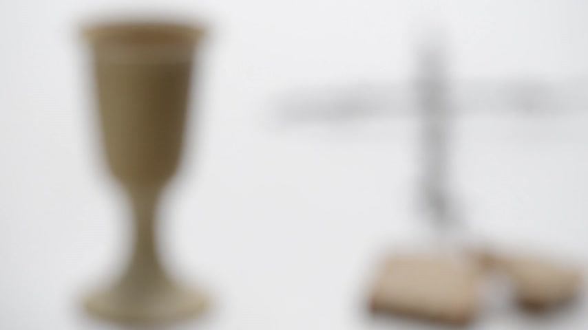 communion : Chalice Of Wine With Bread And Crucifix On The Burlap .. Rack Focus. Stock Footage