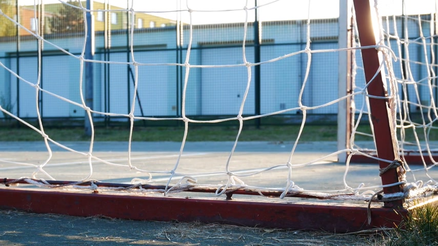 eixo : Detail of Football Goal before Sundown. Panning.