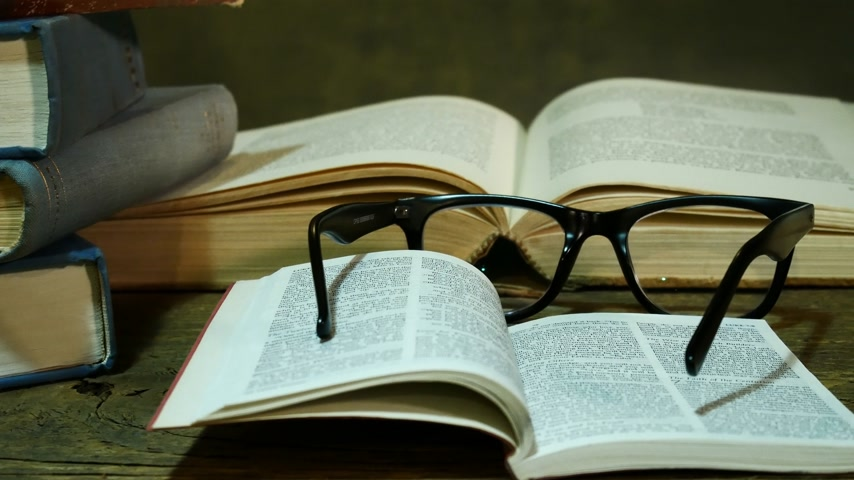 bible study : Open Bible with Glasses on the Used Table. Zoom in. Stock Footage