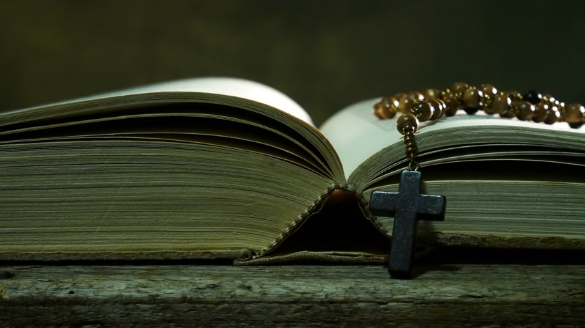 crucifix : Open Bible with Rosary on the Used Table. Sliding. Stock Footage