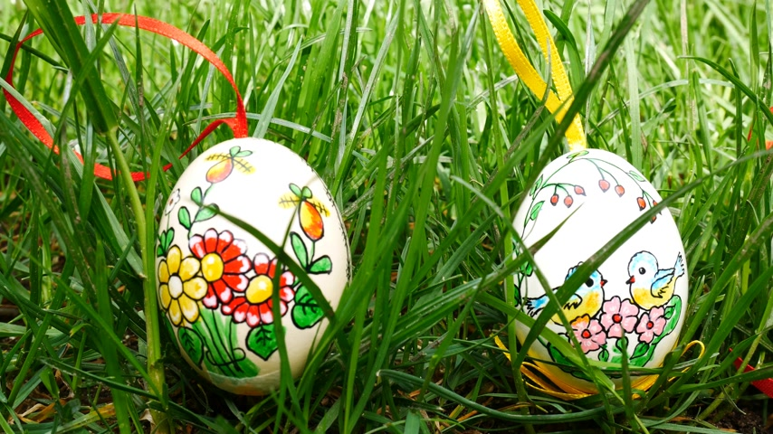 Painted Easter eggs in the grass. Panning.