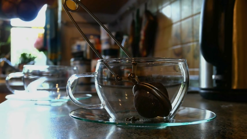 dewy : Pouring Hot Water into Tea Glass. Stock Footage