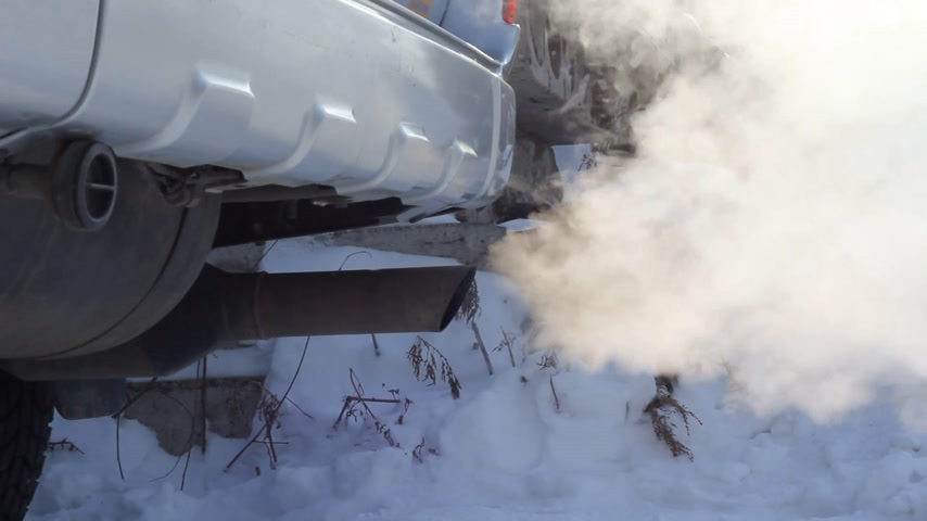 escape : Exhaust gases from the muffler running car Stock Footage