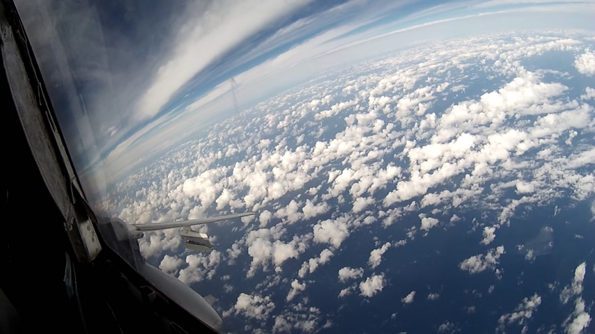 истребитель : Flight over clouds view from cockpit plane.