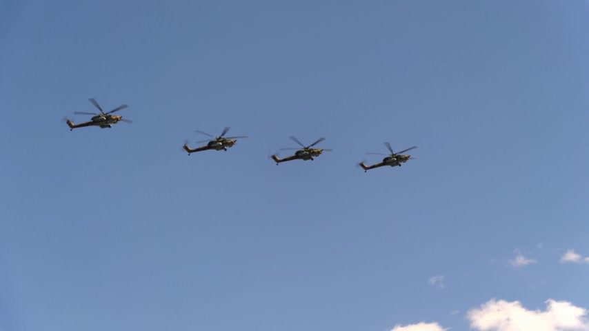mi : Combat helicopters Mi-28 fly in blue sky