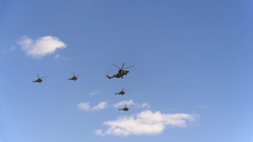 mi : Combat helicopters Mi-26 and Mi-8 fly in sky