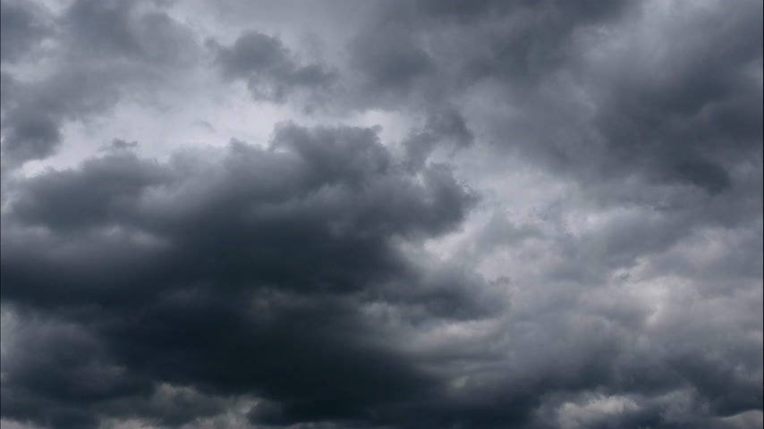 impending : Time lapse Nature background Ominous clouds drift slowly across the sky, threatening rain. UltraHD stock footage.