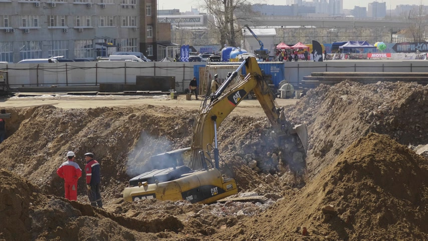 opencast : MOSCOW - MAY 11, 2018: Heavy mining excavator loads rock ore into on May 11, 2018 in Moscow, Russia