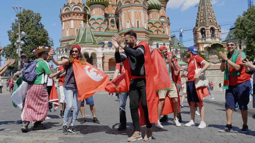 tunisia : MOSCOW - JUNE 20, 2018: Soccer World Cup Fanatics of Morocco, Tunisia with flags with their typical costumes in the streets June 20, 2018 in Moscow, Russia