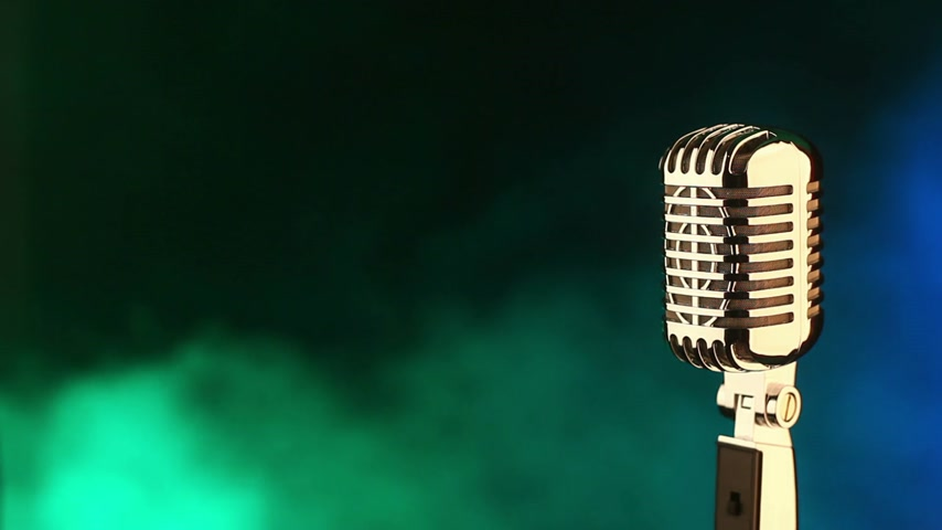 karaoke : Vintage microphone on green and blue smoke background