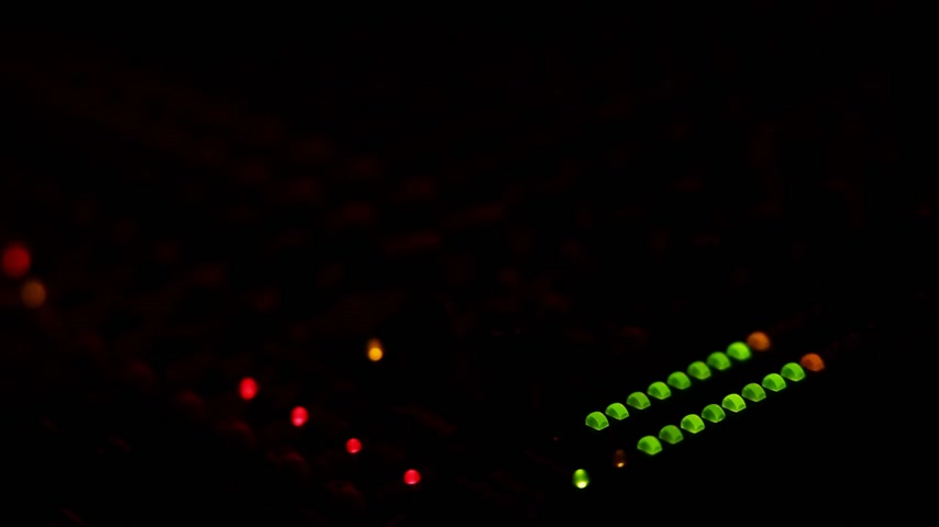 lighting equipment : Mixing board at a concert with red and blue light turning on and off
