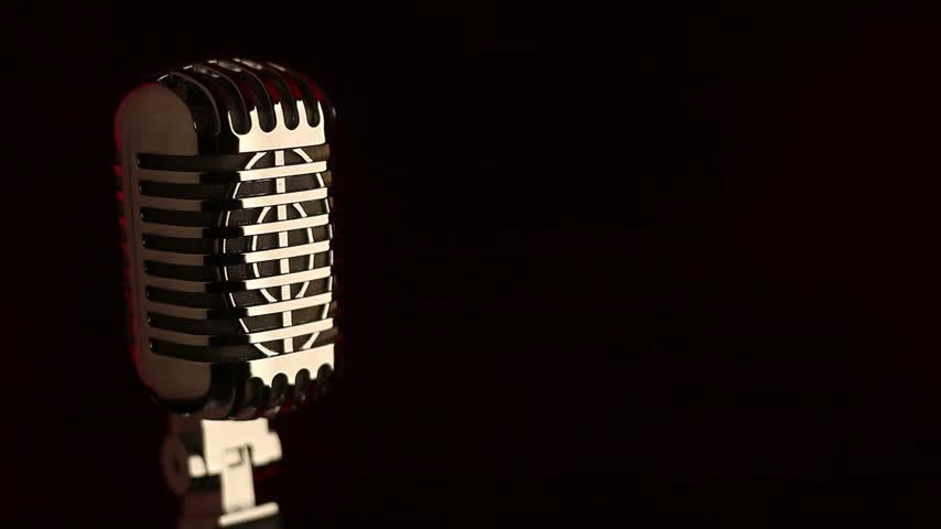 caz : Retro microphone in front of red smoke background Stok Video