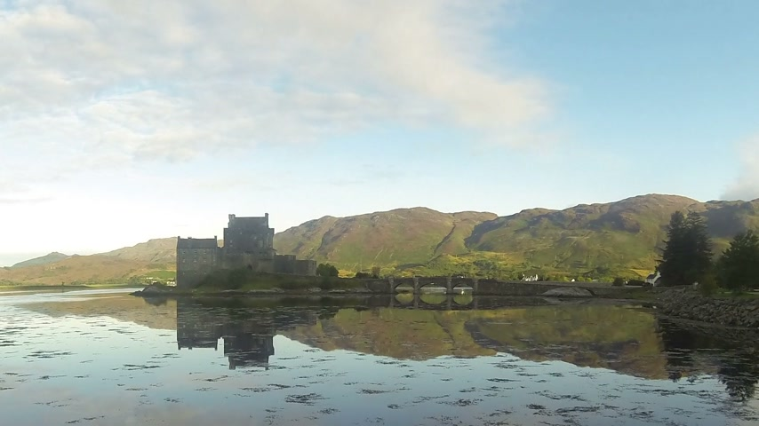 felvidéki : Dornie, Scotland - 24 August, 2014: Timelapse of Eilean Donan Castle in Scotland.