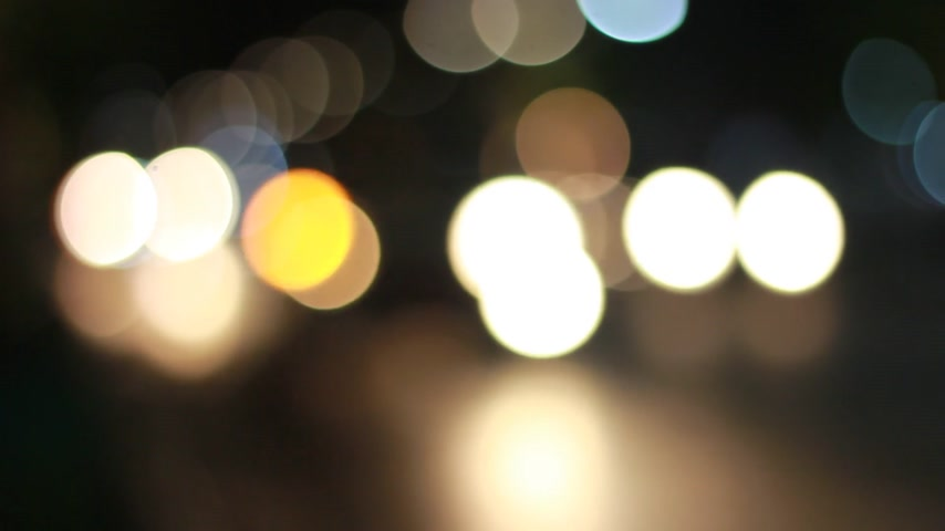 blurring : slowly beauty bokeh blur yellow light moving from left to right footage for background abstract Stock Footage