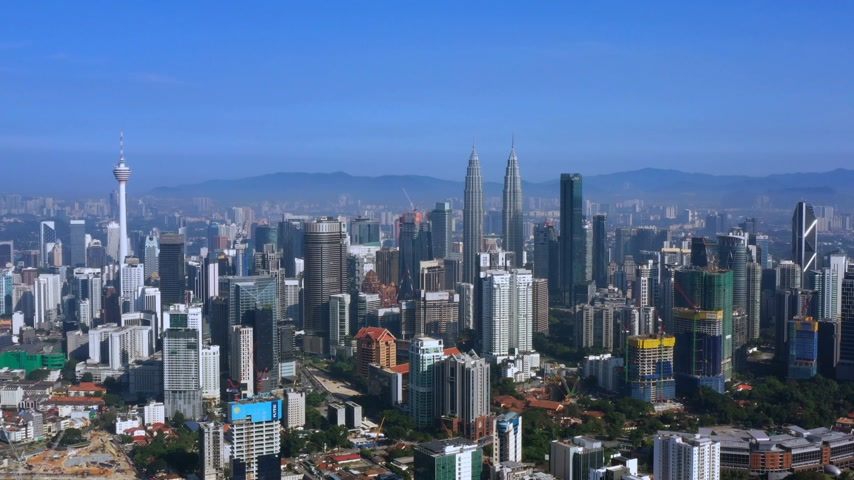 ikrek : KUALA LUMPUR, MALAYSIA - OCTOBER 16, 2019 : Aerial view of Kuala Lumpur cityscape. Highrise buildings including Petronas Twin Towers and Kuala Lumpur Towers.