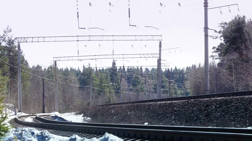 truck crane : freight train in movement at winter day