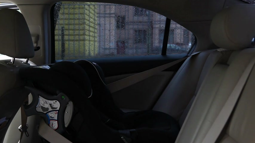 newborn child : mother put child in safety car seat Stock Footage