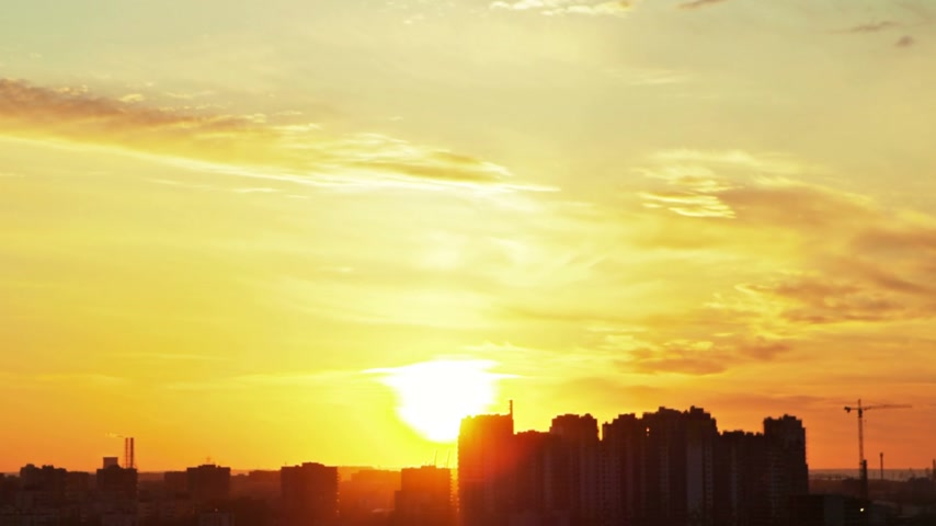 evening sun : sunset over city, aerial view, timelapse