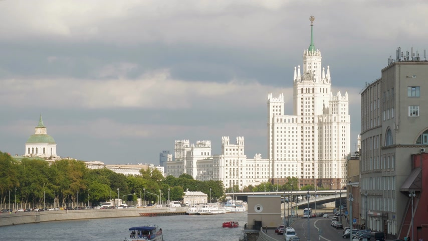 stalinist : Beautiful white sunlit Kotelnicheskaya Embankment Building and Moskva river navigation. It is one of the Seven Sisters (Soviet skyscrapers) built in Stalin period. 4K Stock Footage