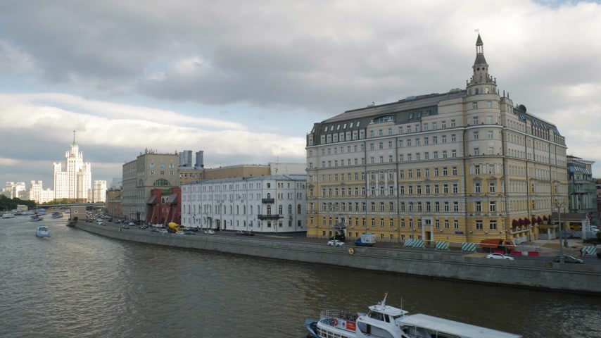 stalinist : Tourist ship on Moskva river moving towards Kotelnicheskaya Embankment Building. It is one of the Seven Sisters (Soviet skyscrapers) built in Stalin period. 4K