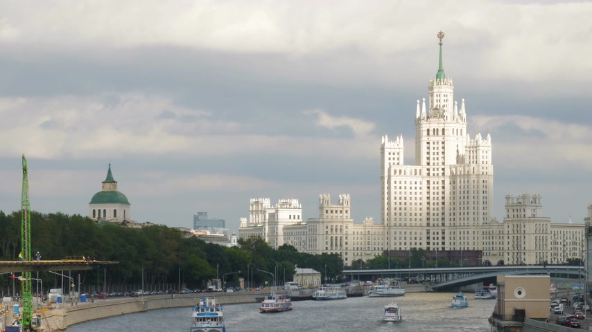 stalinist : Huge white Kotelnicheskaya Embankment Building and Moskva river navigation. This historic building is one of the Seven Sisters (Soviet skyscrapers) built in Stalin period. 4K Stock Footage