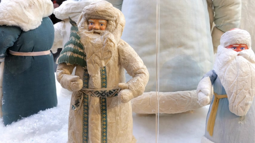 ded : Soviet vintage santa claus figurines (ded moroz) on display in shopping mall. Panning, close up. 4K Stock Footage