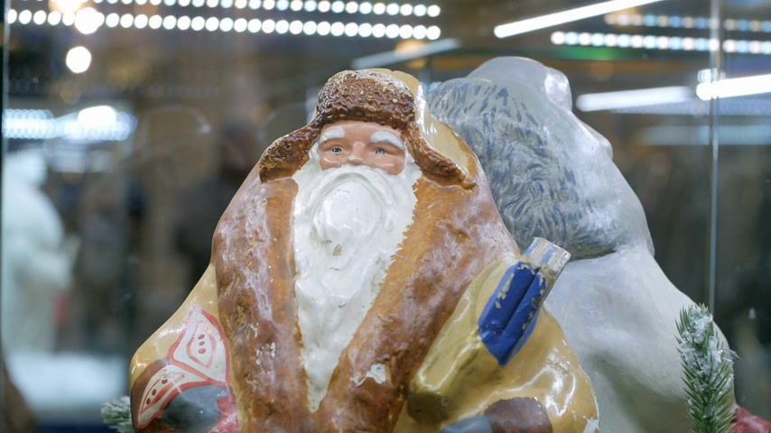 ded : Soviet vintage santa claus (ded moroz) figurine on display in shopping mall. Close up.