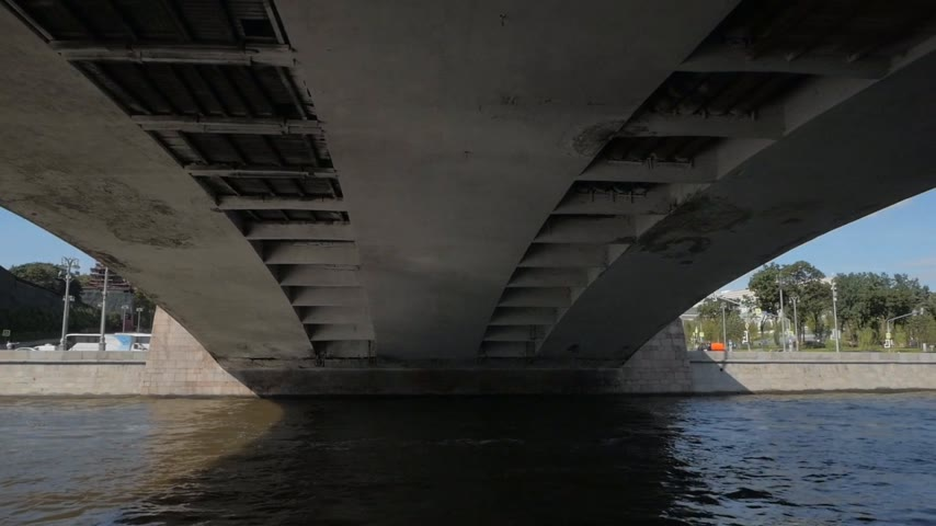 View from boat passing under bridge showing its construction