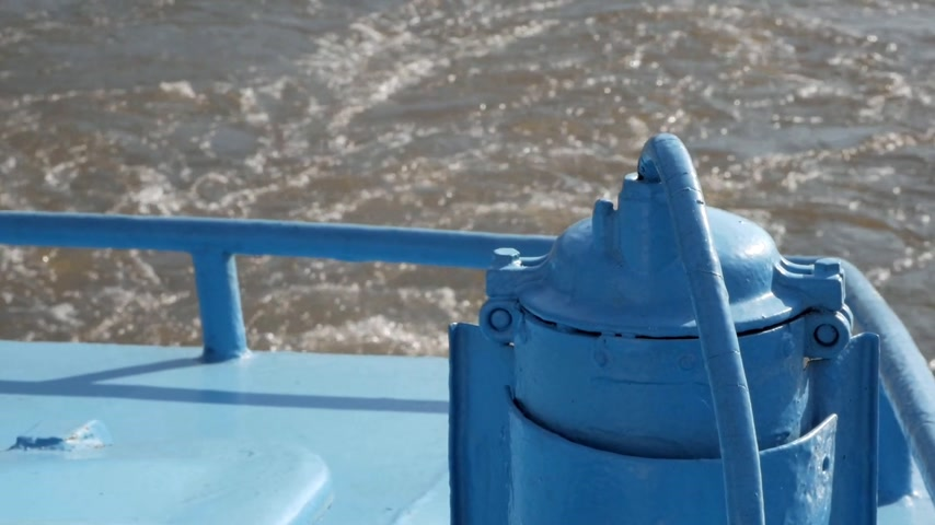 Close up on part of blue ship and back view on boat trace Stock Footage