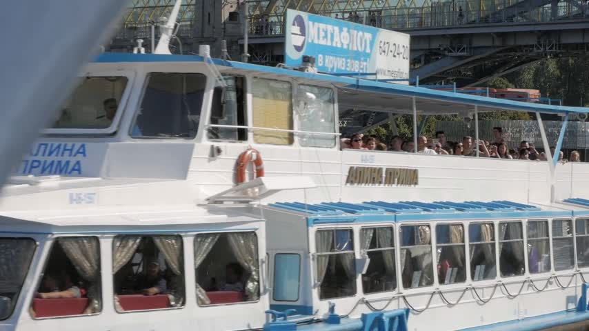 boat tour : MOSCOW - AUGUST 17, 2018: Summer navigation in Moscow, Russia. Many tourists take boat trips along Moskva river embankment to see its beautiful sights and landmarks from water.