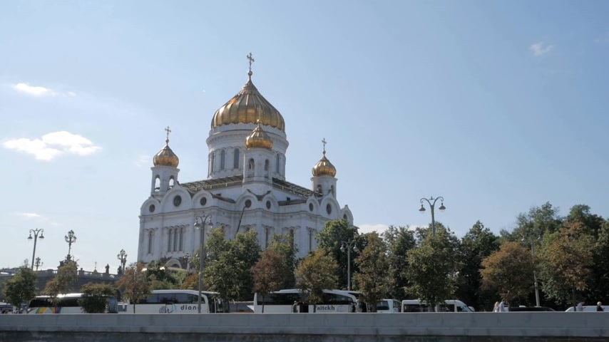MOSCOW - AUGUST 17, 2018: Tourist buses waiting for tourist groups outside of monumental Christ the Saviour Cathedral with golden domes