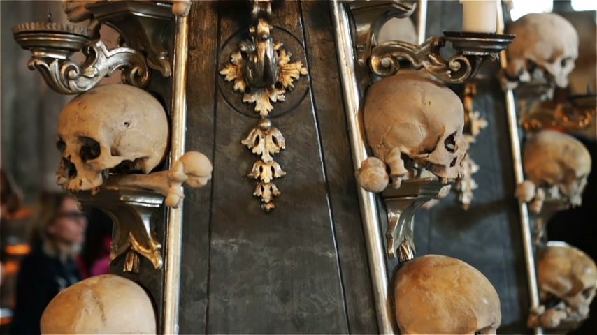 kutna : Czech Republic. Kutna Hora. Skulls and bones in the ossuary in Kutna Hora Stock Footage
