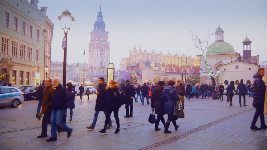 largest city : Krakow, Poland - January 18: Tourists stroll along the beautiful street in the old town Stock Footage