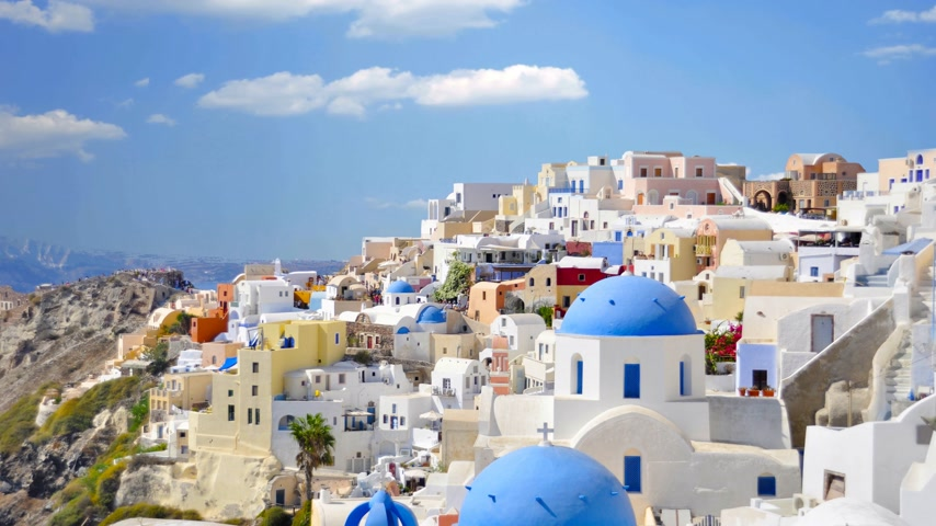 görögország : White houses and blue roofs Santorini Greece. Stock mozgókép