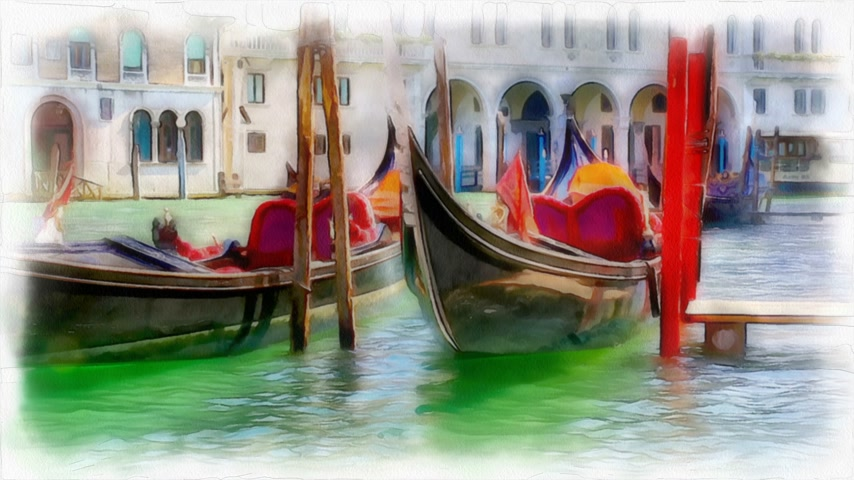 beautiful Venetian gandols are rocking on the waves. Grand Canal in Venice