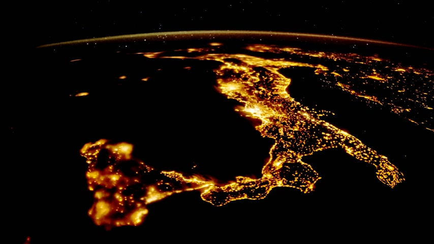 wide lens : Flying over the earths surface, shot from the space station. Flying over Italy Stock Footage