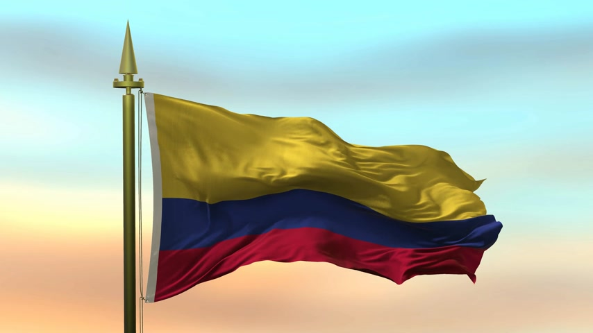 godło : National Flag of  Colombia waving in the wind against the sunset sky background slow motion Seamless Loop Animation
